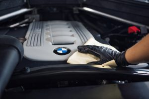 bmw engine being wiped by mechanic
