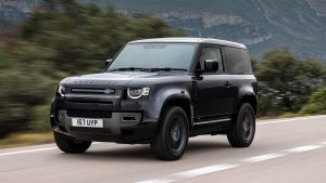 black land rover on road