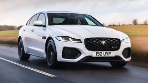 white jaguar on road